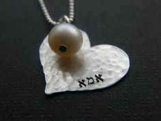 Mother charm with pearl by Simag, $36.00