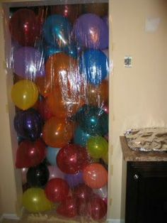 Baloon Shower - great for Kids! While they are asleep, Wrap a Wall of Balloons on the outside of their closed bedroom door! Also great for Birthdays!