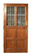 RECLAIMED GLAZED OAK DOOR C. 1950. Glass is leaded effect. A good quality door which would be improved by stripping and re-finishing.Height 199.5 cmWidth 97.5 cmThickness 4.4 cm