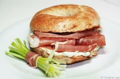 prosciutto and goat cheese on a bagel