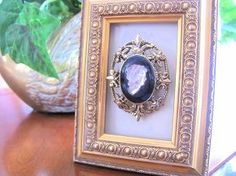 how to use old jewelry around your home, home decor, I used a small frame that I had and put a pretty brooch in it