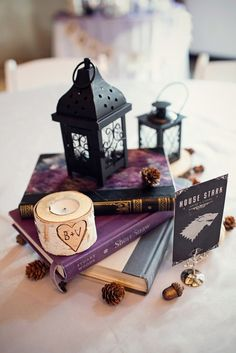 Medieval fantasy lover Wedding in a Castle: Ben & Victoria >> That's a House Stark table number! It's pretty classy! Love that a hawk brought them their wedding rings!! Omg
