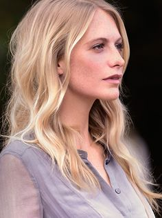 British model Poppy Delevingne arrives at the Burberry S/S15 show