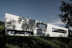 """Marte.Marte Architects recently designed a home named """"House of Yards"""", a contemporary oasis which overlooks the Rhine Valley in western Austria.  Frameless windows and breakthroughs in the building provide a virtually unobstructed view of the Austrian countryside, and also allow for natural lighting to illuminate the home.  Decorated with a blend of concrete and natural wood, the kitchen, bedroom and living quarters come together in a U-shape on one level, while the lower floor welcomes the…"""