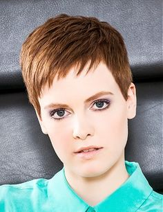 A short brown straight COPPER hairstyle by Guys & Dolls Intercoiffure