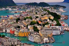 The city of Ålesund is known for its architecture in Art Nouveau style, its surrounding fjords and the high peaks of the Sunnmøre Alps Norway