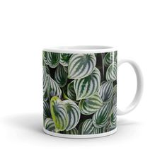 A true coffee lover knows that each variety of this aromatic drink deserves a special cup and this Watermelon Peperomia Coffee Mug fits that bill. This durable ceramic coffee mug with high-quality sublimation printing makes it a gift appreciated by any latte or coffee drinker.  .: White ceramic .: 11 oz (0.32l) .: Rounded corners .: C-Handle 11oz Height, 10cm Diameter 9cm Latte Mugs, Coffee Mugs, The Last Drop, Kitchenware, Tableware, Monstera Deliciosa, Coffee Drinkers, Cold Drinks, Travel Size Products