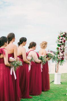 Cherry red bridesmaid gowns: http://www.stylemepretty.com/little-black-book-blog/2016/06/30/red-hawaiian-wedding/ | Photography: Aria Studios - http://www.ariastudios.com/
