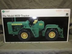 ERTL John Deere Model 8020 Tractor. Example of an Auction Item Sold Online by Hansen & Young, Inc. Auction Items Were Located at Prairie Farm, WI.