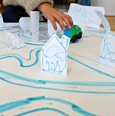 Kids make their own towns and maps! This is such a clever idea and very engaging. Great for little ones learning about mapping, and also helps develop fine motor skills and cutting!