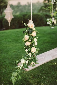 Flower covered swing | Les Amis Photo | see more on: http://burnettsboards.com/2015/05/midsummer-nights-dream-tuscany-wedding/