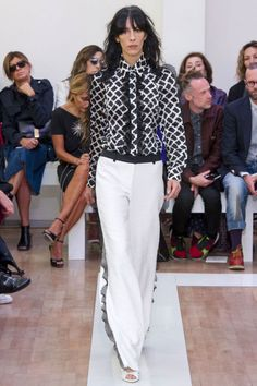 As delicate as lace and flowers can be, this was a hyper-feminine take on dressed-up lady looks. When the palette wasn't black-and-white, Puglisi ramped up the color and the details—like gills of netting running not just along plackets but along sleeves and in lieu of tuxedo stripes on pants.