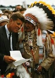 John Kennedy with Native American chief. c. 1962