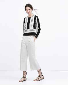 Image 1 of GOLD BUTTON CROPPED TROUSERS from Zara