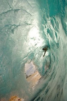 The beauty of this shot makes you overlook the fact that this guy is about to be face-planted in the sand.