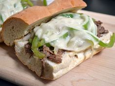 Quick and easy Philly cheesesteak sandwiches using slow cooker shredded beef and quickly sautéed onions and bell peppers.
