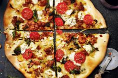Recipe: Spicy sausage pizza with garlic rapini and ricotta
