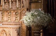 These arrangements were on either side of the altar. Baby's breath with paper cutouts of birds and butterflies ~ we ❤ this! moncheribridals.com