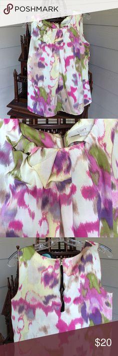 Silky sleeveless she'll Pretty, comfortable, floral, sleeveless top.  Zippered back Loft Tops