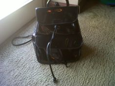 Coccinelle patent leather backpack