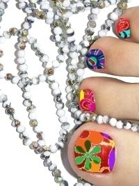 Simply colored toenails are no longer considered fashionable, so if you wish to maintain your iconic style, you should definitely experiment with more sophisticated pedicure nail art designs as the sky is the limit when it comes to design, color and products you can turn towards to beautify your feet.