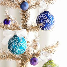 Swirls, teardrops, and tiny dots cover satin ball ornaments like frost on a winter windowpane! http://www.bhg.com/christmas/ornaments/christmas-tree-ornaments/?socsrc=bhgpin112514paisleygemtreeornaments&page=10