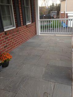Grey Quartz Veneered Inlay on Porch Floor with Limestone Coping Landscape Materials, Landscape Design, Bluestone Pavers, Step Treads, Sandstone Wall, Natural Stone Veneer, Landscape Maintenance, Porch Flooring, Outdoor Areas