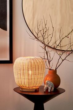 Woven wicker table lamp that sends a soft vintage-inspired glow allover. Fitted on a round wooden base. Plugs in to power on. Wicker Table, Metal Table Lamps, Glass Table, Cute Bedroom Decor, Woven Shades, Lantern Designs, Paper Table, Classic Rugs, Home Lighting