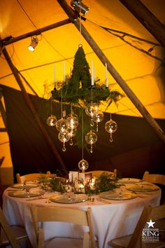 Don't know what's happening with the strange Tent but this chandelier & moss & tablescape...gasp