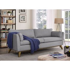 This simple Sussex sofa features grey, polyester upholstery with piping trim that will add splendor to any room. Retro-shaped legs complete the look, and the wood frame makes this piece sturdy and durable.