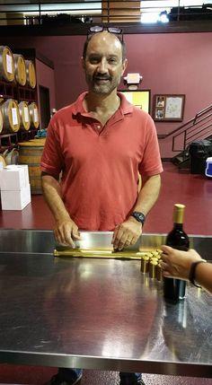 """Putting heat seals on the bottles"" Janssen pharmaceuticals team building through winemaking at Grape Finale Hands-On Winery. Team Building, Seals, Bottles, Hands, Wine, Mens Tops, Seal, Harbor Seal"