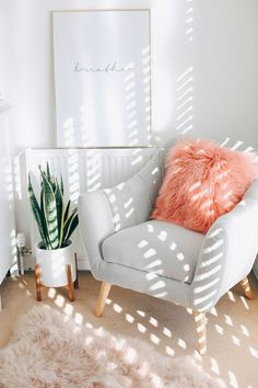 Planning a bedroom make over + Room Tour: Read to hear my tips on redecorating your bedroom from planning your makeover to colour palettes, lighting and storage. Also, how cute is this grey armchair? The furry cushion, mothers tongue plant and nude fur rug just complement it perfectly! #CuteRugs