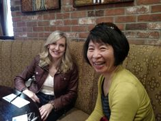 Two Global Gals sharing a laugh at our Global Gal Get Together.