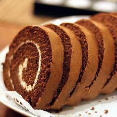 Making a beautiful, perfectly spiraled roll cake is not as hard as it seems! With a good cake recipe and the right technique, it's actually very easy to whip one of these delightful desserts for yourself. The recipe here is a Chocolate roll cake with whipped cream chees