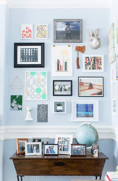 This might be the most epic gallery wall EVER. Wanna plan out your own wall? It all starts with cutting out pieces of craft paper and then taping them on the wall. Before you get started, you'll need these key items: picture hanging kit, drill, level, hammer and nails. #partner