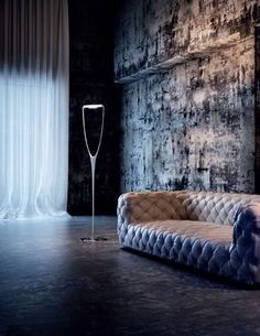 'Dream' by Vistosi. The Dream collection enhances the uniqueness of carbon fiber. An apparently fragile floor lamp having a strong structure that supports the reflector that can be orientated. www.essessltd.com