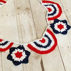 """These awesome, """"4th of July Banner"""" would be loved by everyone. Show off your crochet skills and enjoy this year's Independence Day with a creative touch. The lovely colours of American Flags in a lovely 4th of July Bunting and Garland. Enjoy these Free Crochet Patterns"""