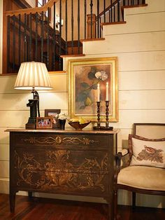 Lindy Thomas Interiors Neutral wall, dark dresser, lamp, artwork, chair and cushion. Good balance of dark and light colours and tones