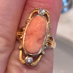 This is from the early 1900's. It's stunning . Peach colored angel  skin corral ring. It's from the Art Nouveau period . No stamp due to sizing to a 7. Two tested natural diamonds and top measures .95 inches. THIS IS A STUNNING ANTIQUE! SEE MY OTHER GOLD JEWELRY LISTED Cameo Ring, Peach Colors, Natural Diamonds, Vintage Rings, Art Nouveau, Gold Jewelry, Period, Gemstone Rings, Angel