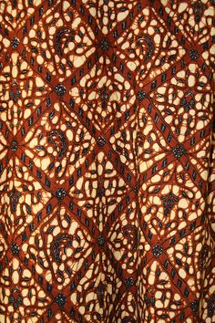 Image of Javanese court batik, in typical reddish-brown color, from Indonesia.  fig. 1 Javanese court batik, in typical reddish-brown color, from Indonesia. The development and refinement of Indonesian batik cloth was closely linked to Islam.(伊斯蘭)