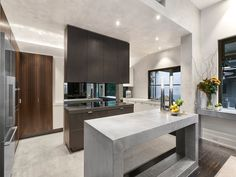 Modern kitchen design with SEMCO concrete countertop, seamless floors and walls to complete the modern design. Concrete Countertops, Kitchen Design, Kitchen, Countertops, House Interior, Apartment Chairs, Modern Design, Apartment Interior, Modern Kitchen Design