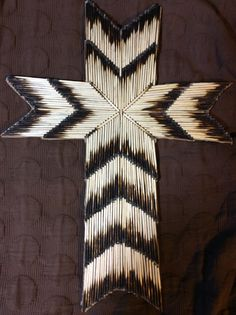 Cross made out of burnt matches.