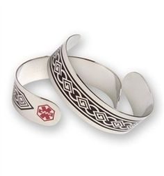 """Medical Id Bracelet with style!!  Excellent alternative to those who demand Discreet protection. This is a unisex stainless steel cuff bracelet with Tribal design. Medical Symbol is On both ends of the cuff. The cuff is 3/4"""" wide. This bracelet is a one size fits all, but best fits wrists 7""""-9"""". Diabetes is engraved on the inside."""