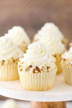 Almond Amaretto Cupcakes - almond cupcakes and frosting with a whipped amaretto filling! These Almond Amaretto Cupcakes have a moist almond cupcake, almond frosting and a fluffy white chocolate amaretto center! Almond Frosting, Almond Cupcakes, Tiramisu Cupcakes, White Cupcakes, Giant Cupcakes, Vanilla Buttercream, Buttercream Frosting, Best Cupcakes, No Bake Desserts