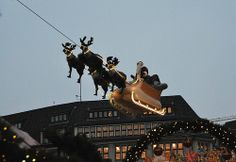 Hamburg Rathausmarkt - Flying Santa Claus. On the front of the imposing City Hall in Hamburg, the probably most popular Christmas market in Hamburg is located. Nostalgia and intense sociability.