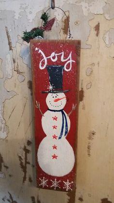 Primitive snowman on pallet wood