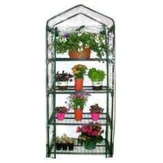 Any garden can accommodate this multi-tier mini greenhouse. The Gardman Four Tier Mini Greenhouse can be positioned on a deck, patio, or balcony. It has a sturdy, tubular steel frame and a removabl… Portable Deck, Portable Greenhouse, Small Greenhouse, Greenhouse Plans, Greenhouse Gardening, Indoor Greenhouse, Greenhouse Cover, Greenhouse Supplies, Aquaponics Garden