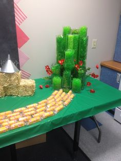 """Wizard of Oz Teacher Appreciation week. Used twinkies to Create a Yellow Brick Road. Used cheap clearance easter grass 9 cents a bag to fill assorted glass containers to create a """"Emerald City"""""""