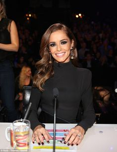 Picture perfect: Cheryl added a touch of the glitz to the ensemble with stunning 1980s Giv...