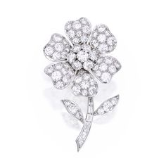 PLATINUM AND DIAMOND 'PAVOT' BROOCH, VAN CLEEF & ARPELS Of floral design, set with round, baguette and fancy-shaped diamonds weighing approximately 7.00 carats, signed V.C.A., numbered N.Y.39729. Estimate 15,000 — 20,000 USD  LOT SOLD. 18,750 USD